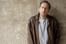 Michael Smiley as David Penry against a wall in Talking To The Dead