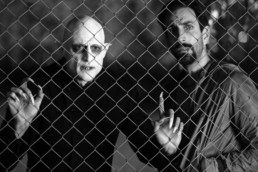 Mark Strong as Nosferatu and Petr Vanek as Fonso behind a fence in Nosferatu In Love