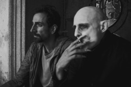 Mark Strong as Nosferatu smoking a cigarette with Petr Vanek as Fonso in Nosferatu In Love