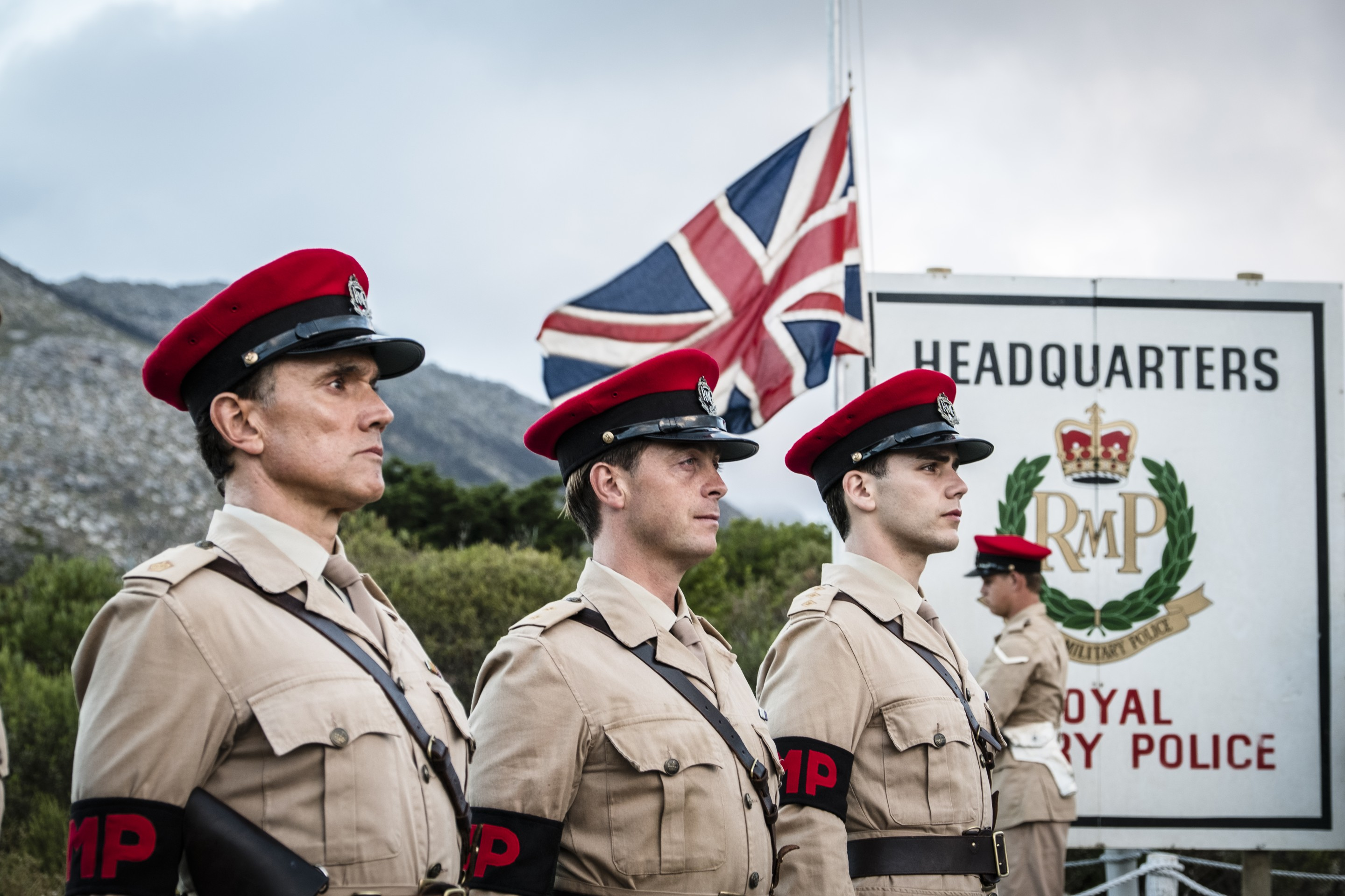 Ben Miles, Stephen Campbell Moore and Jeremy Neumark Jones as Major Harry Markham, Lieutenant Ed Laithwaite and Captain Joe Martin stand to attention in The Last Post