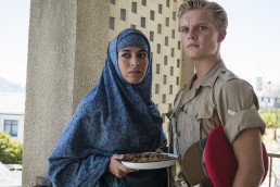 The Last Post series Yusra Saeed played by Ouidad Elma and Lance Corporal Tony Armstrong look on