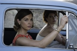 Jessica Raine as Alison Laithwaite smoking and Honor Martin sit in the car in The Last Post