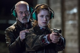 Sophie Rundle as DC Fiona Griffiths aim a revolver with Keith Allen as Robbie Griffiths in Talking To The Dead
