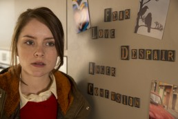 Sophie Rundle as DC Fiona Griffiths in the kitchen in Talking To The Dead